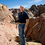 Valley of Fire, Nevada - This is me; my brother Bob took the photo.  I am slouched forward because I am carrying a Nikon D2X with Nikkor 15 - 55 mm zoom lens - a nice but heavy camera and lens.